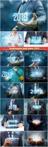Businessman hand shows 2018, concept of a new year