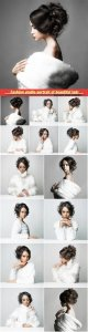 Fashion studio portrait of beautiful lady with elegant hairstyle in white fur coat
